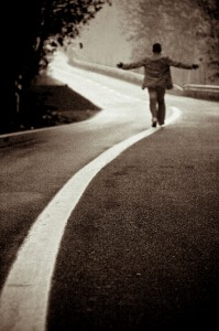 Man on Road by flickr user Shahram Sharif